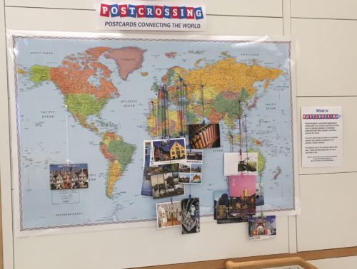 Photo of map with postcard display