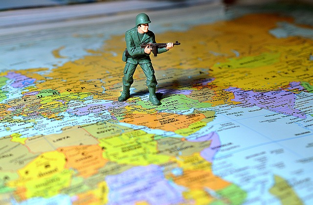 Toy soldier standing on map of Middle East